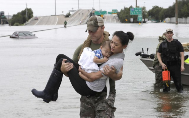 These Photos of Hurricane Harvey Rescuers Will Restore Your Faith in Humanity