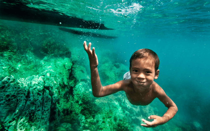 These Kids Can Swim Underwater Like Mermaids & See Like Dolphins. Here's How