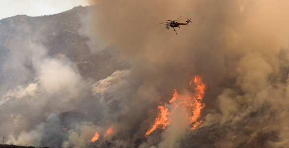Wildfires aren't just burning out of control, they're linked to a rise in Covid